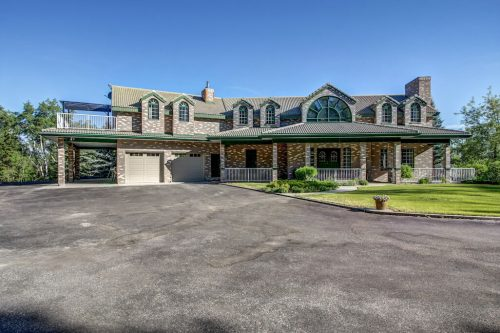 brick-facade-exterior-dormers-arch-mansion-luxury-176127-168-Avenue-W-Priddis-Alberta-Calgary-Acreage-Real-estate-for-sale-plintz-luxury-home