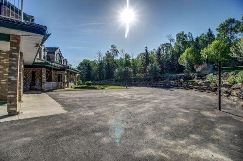 driveway-basketball-net-paved-176127-168-Avenue-W-Priddis-Alberta-Calgary-Acreage-Real-estate-for-sale-plintz-luxury-home