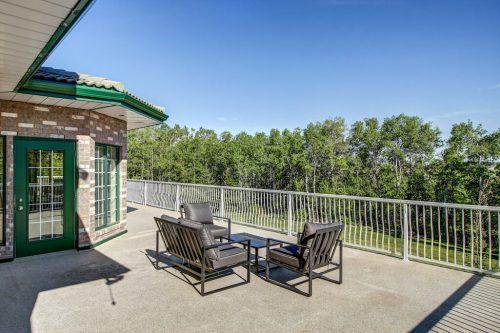patio-furniture-deck-view-trees-176127-168-Avenue-W-Priddis-Alberta-Calgary-Acreage-Real-estate-for-sale-plintz-luxury-home