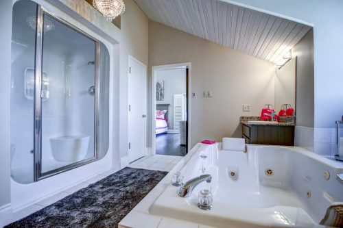 Jetted bathtub with shower and double vanities 176127 168 Avenue W in Priddis, Alberta, Canada. Acreage home for sale by Plintz Real Estate Calgary.
