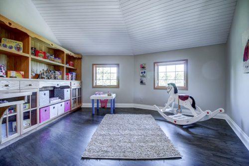 Nursery playroom with rocking horse and hardwood floors