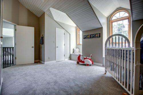 nursery crib dormer arched windows in 176127 168 Avenue W in Priddis, Alberta, Canada. Acreage home for sale by Plintz Real Estate Calgary.