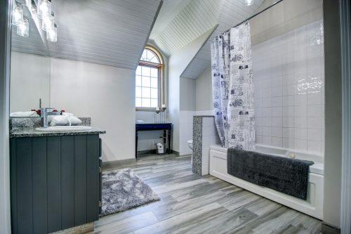 Bathroom tub white tile and vanity