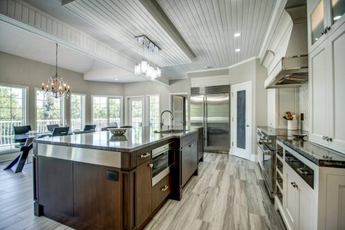 Luxury kitchen with large centre island and two tone millwork