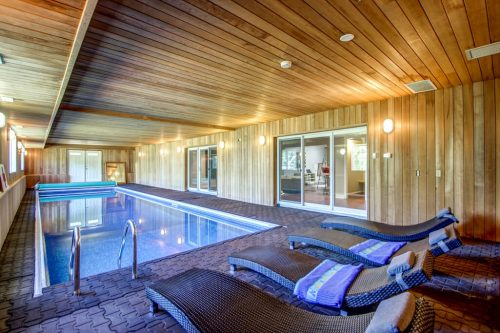 Saltwater indoor pool with cedar walls 176127 168 Avenue W Priddis acreage for sale in Alberta. Home for sale by Plintz Real Estate Calgary