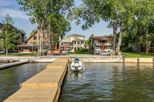Boat launch private dock on Chestermere lake lakefront home