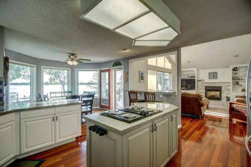 Open concept home with kitchen, breakfast nook and living room with fireplace.