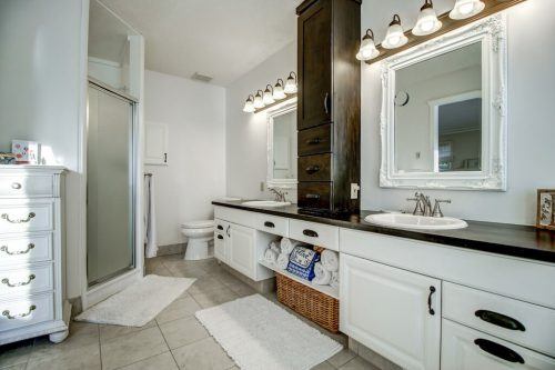 Ensuite bathroom with double vanity and shower.