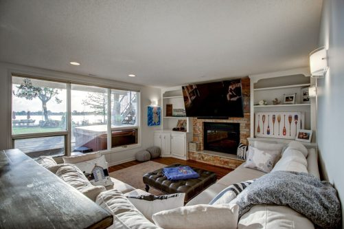 Famiy room with walkout basement with fireplace and views of Chestermere Lake.