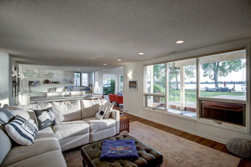 Rec room in walkout basement at 587 East Chestermere Drive Alberta. Home for sale by Plintz Real Estate Calgary.