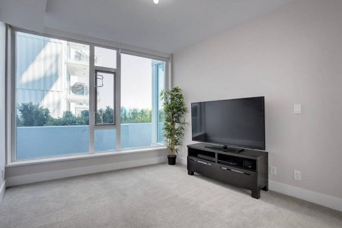 Den-bedroom-balcony-evolution-Realtor-210-510-6-Avenue-SE-east-village-calgary-real-estate-for-sale-condo-plintz-sothebys