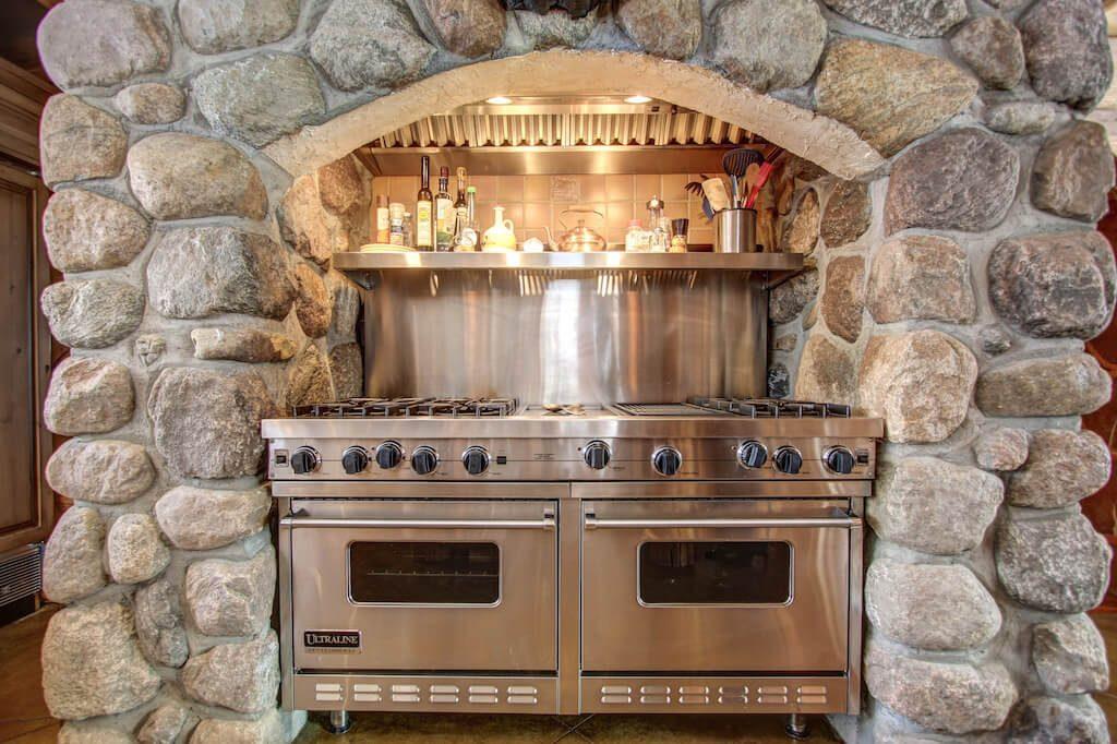 Wolf-range-stone-rock-rustic-kitchen-352248-Pine-Ridge-Road-Bragg-Creek-Ranch-Acreage-For-Sale-Calgary-Real-Estate-For-Sale-taylor-sothebys-Realtor-Plintz