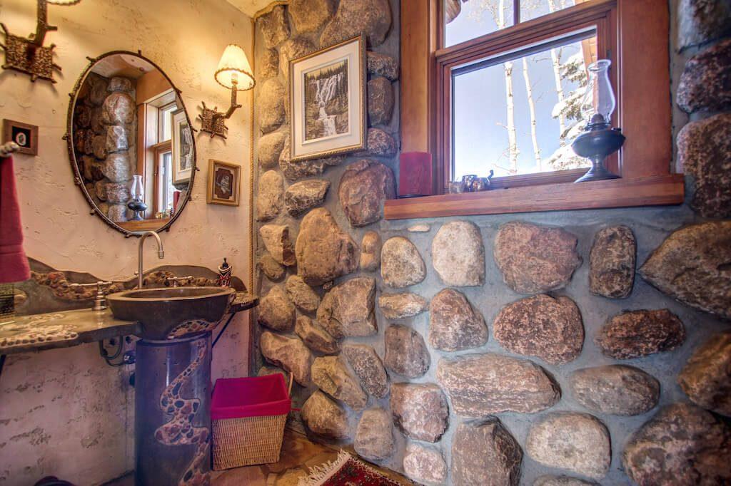 Rustic-rock-stone-bathroom-352248-Pine-Ridge-Road-Bragg-Creek-Ranch-Acreage-For-Sale-Calgary-Real-Estate-For-Sale-taylor-sothebys-Realtor-Plintz