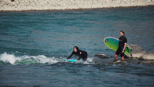 river-surfing-Eau-Claire-Calgary-Plintz-Real-Estate-Bow-River-Condos-Riverfront