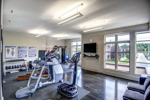 gym-fitness-room-windows-views-hardwood-weights-2605-Erlton-Street-SW-Calgary-Real-Estate-Homes-For-Sale-Realtor-Plintz-Luxury-Custom