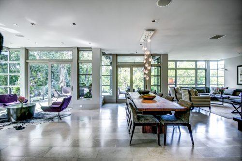 open-concept-dining-pendant-lighting-floor-to-ceiling-windows-living-room-2605-Erlton-Street-SW-Calgary-Real-Estate-Homes-For-Sale-Realtor-Plintz-Luxury-Custom