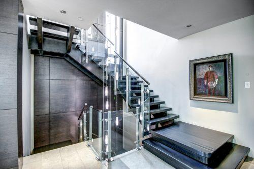 open-stringer-staircase-chandelier-2605-Erlton-Street-SW-Calgary-Real-Estate-Homes-For-Sale-Realtor-Plintz-Luxury-Custom