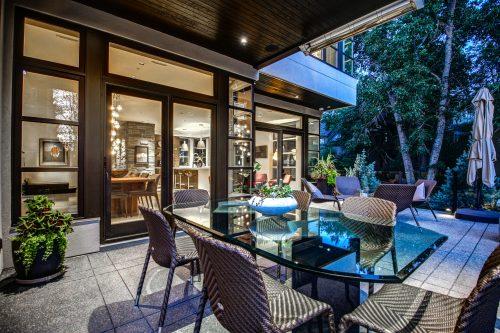 dining-patio-furniture-glass-table-wicker-chairs-deck-2605-Erlton-Street-SW-Calgary-Real-Estate-Homes-For-Sale-Realtor-Plintz-Luxury-Custom