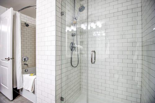 subway-tile-shower-ensuite-13-Avenue-SW-park-calgary-beltline-condo-real-estate-for-sale-plintz