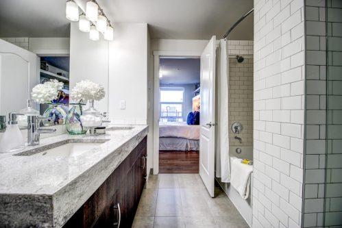 luxury-high-end-ensuite-bathroom-vanity-granite-subway-tile-shower-13-Avenue-SW-park-calgary-beltline-condo-real-estate-for-sale-plintz