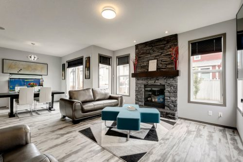 open-concept-stone-fireplace-755-New-Brighton-Drive-Se-Home-House-for-sale-real-estate-calgary-plintz