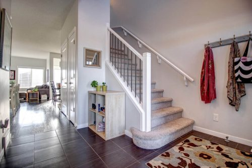 entrance-tile-floor-staircase-317-Nolanfield-Way-NW-Calgary-Real-Estate-Homes-for-sale-house-plintz-realtor-nolan-heights