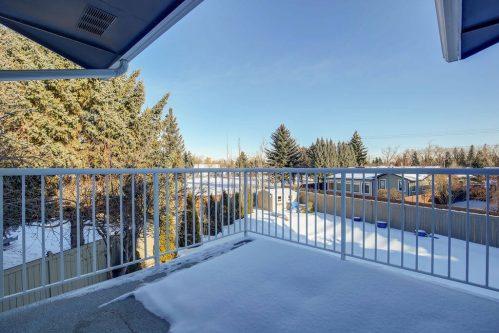 Patio in winter overlooking Lake Bonavista neighbourhood in Calgary Alberta.