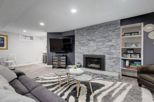 basement-family-room-stone-fireplace-147-Lake-Tahoe-Green-SE-Bonavista-Calgary-Homes-For-Sale-Plintz-Real-Estate-realtor