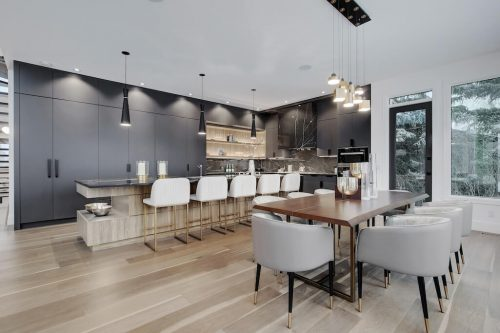 Modern interior design in luxury home. Open kitchen dining room with mid-century furniture.