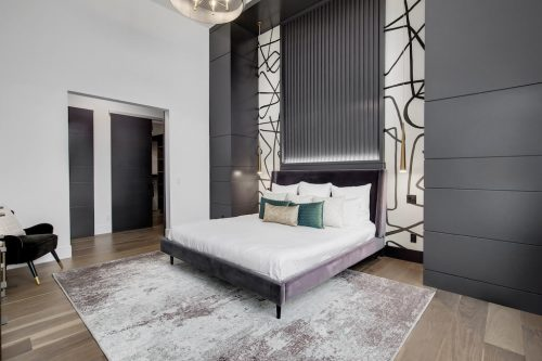 Modern interior design master bedroom with black and wallpaper accents if Scarboro Calgary Alberta home for sale.