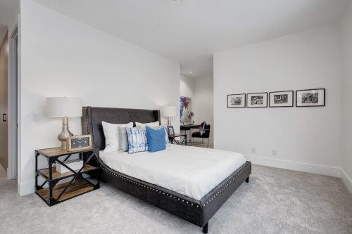 Bedroom in luxury home at 2432 Sovereign Crescent SW home for sale by Plintz Real Estate.