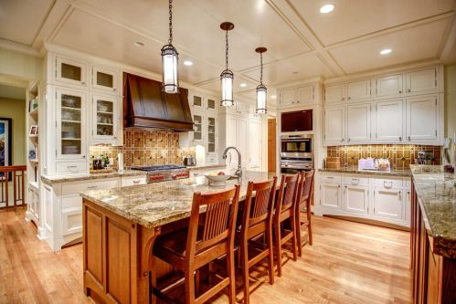 Luxury kitchen with double island and two-toned cabinetry.