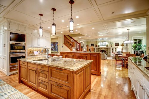 Empire Custom Kitchen with dual island and two-tone cabinetry.