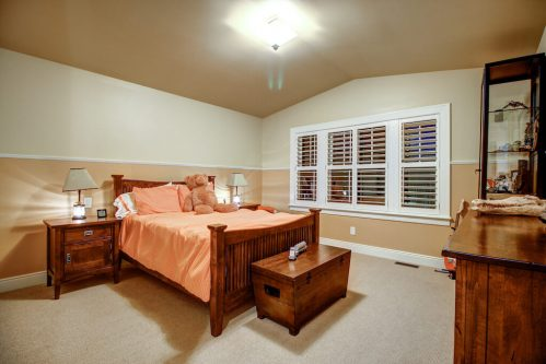 Bedroom with vaulted ceiling in Calgary inner city home.