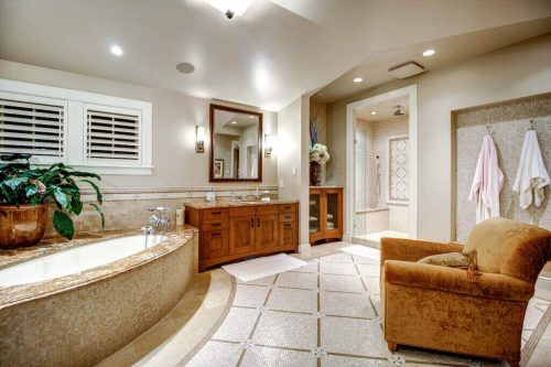 Bathroom with vaulted ceiling and oval corner tub in Rideau Park home.