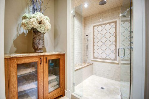 Bathroom with tile and glass shower.