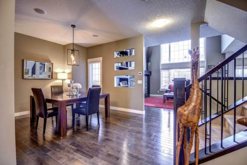 dining-rrom-wall-cutouts-14-Aspen-Dale-Court-SW-Home-For-Sale-Plintz-Real-Estate-Calgary-Woods-Luxury-Alberta-Realtor