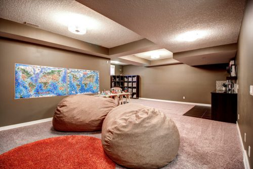 Basement recreation room with large bean bags.