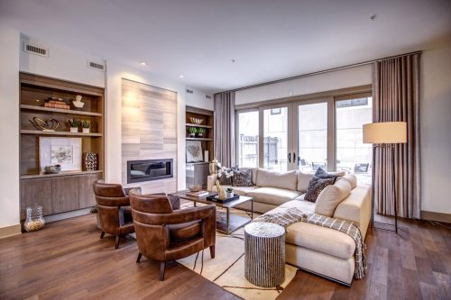 living-room-fireplace-Valour-Circle-SW-Park-Empire-Custom-Homes-Townhome-Luxury-Plintz-Real-Estate-For-Sale-Calgary-currie-barracks