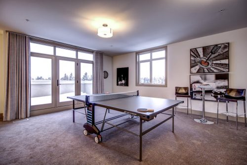 pingpong-games-room-balcony-Valour-Circle-SW-Park-Empire-Custom-Homes-Townhome-Luxury-Plintz-Real-Estate-For-Sale-Calgary-currie-barracks