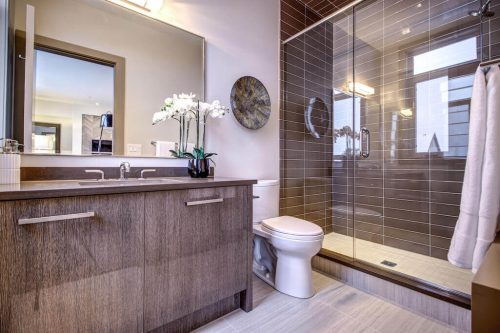 Modern bathroom with glass subway tile shower in luxury townhome.
