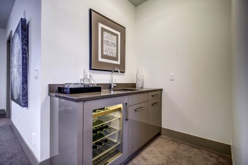 wetbar-game-room-Valour-Circle-SW-Park-Empire-Custom-Homes-Townhome-Luxury-Plintz-Real-Estate-For-Sale-Calgary-currie-barracks