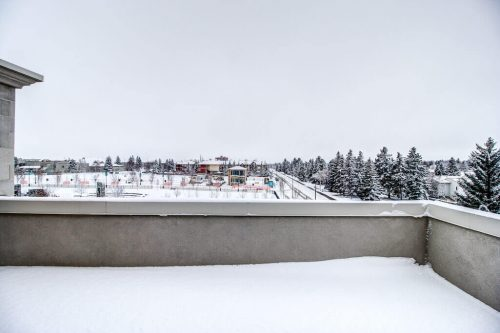 balcony-views-winter-landscape-Valour-Circle-SW-Park-Empire-Custom-Homes-Townhome-Luxury-Plintz-Real-Estate-For-Sale-Calgary-currie-barracks