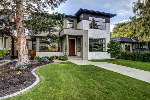 Modern home design of two-storey home with large windows of Calgary inner city house for sale by Plintz Real Estate.