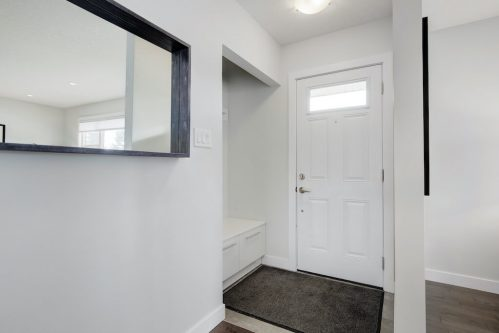 Mudroom entry of bungalow for sale in Calgary by Plintz Real Estate.