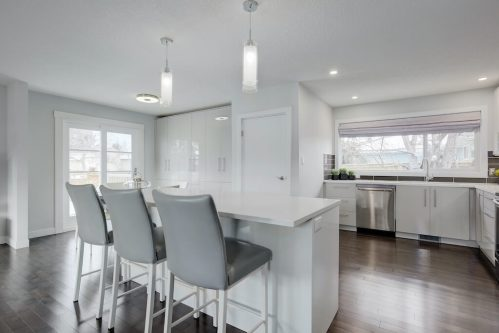 white-kitchen-cabinetry-3828-41-Avenue-SW-Glenbrook-Glamorgan-Calgary-Inner-City-Bungalow-For-Sale-Plintz-Real-Estate-Basement-Suite-Renovated