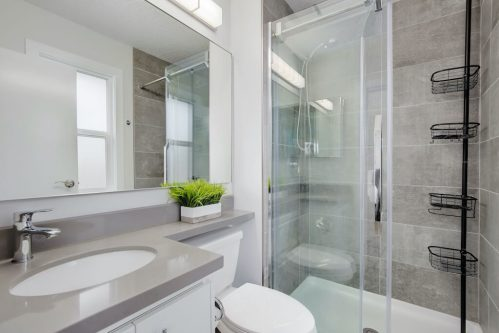ensuite-glass-shower-3828-41-Avenue-SW-Glenbrook-Glamorgan-Calgary-Inner-City-Bungalow-For-Sale-Plintz-Real-Estate-Basement-Suite-Renovated