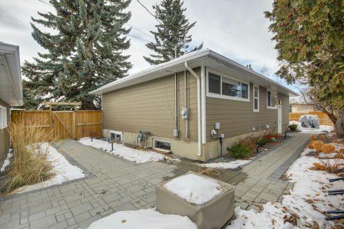 Paving stone sidewalks of bungalow home for sale in Calgary Alberta.