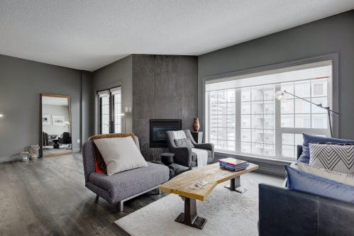 Mid century style renovated condo with concrete fireplace in Beltline condo.