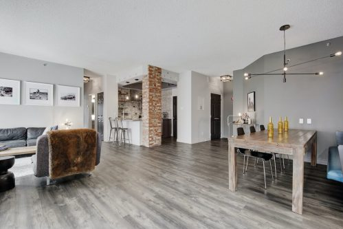 Loft condo with exposed brick pillar for sale by Plintz Real Estate in Calgary.